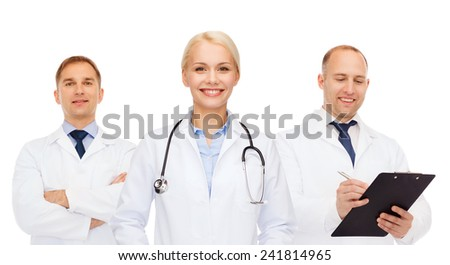 healthcare, people and medicine concept - group of doctors with stethoscopes and clipboard over white background - stock photo