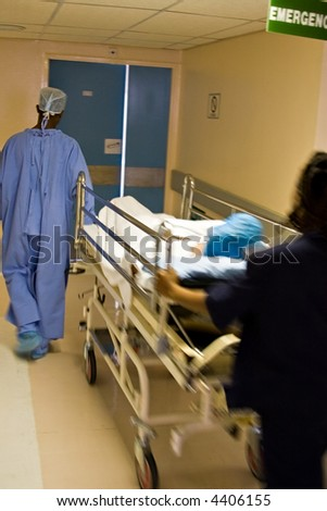 Healthcare personnel carry in a rush one patient, medical series - stock photo