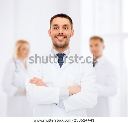 healthcare, profession and medicine concept - smiling male doctor in white coat over white background - stock photo