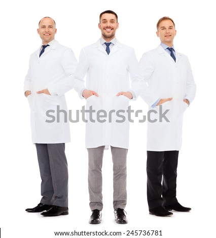 healthcare, profession and medicine concept - smiling male doctors in white coats over white background - stock photo