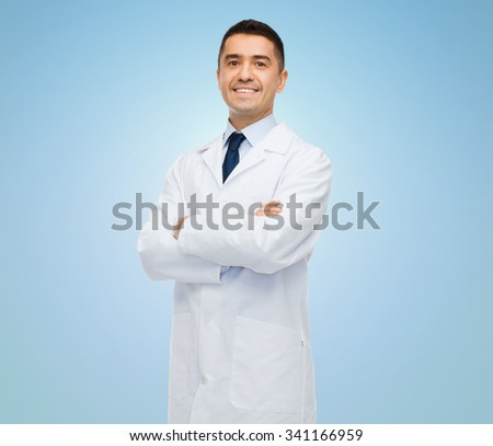 healthcare, profession, people and medicine concept - smiling male doctor in white coat over blue background - stock photo