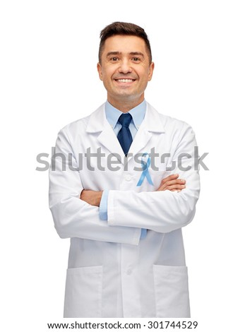 healthcare, profession, people and medicine concept - smiling male doctor in white coat with sky blue prostate cancer awareness ribbon - stock photo