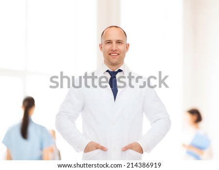 healthcare, profession, teamwork and medicine concept - smiling male doctor in white coat over group of medics - stock photo