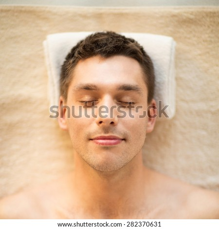 healthcare, spa and beauty concept - close up of man face in spa salon - stock photo