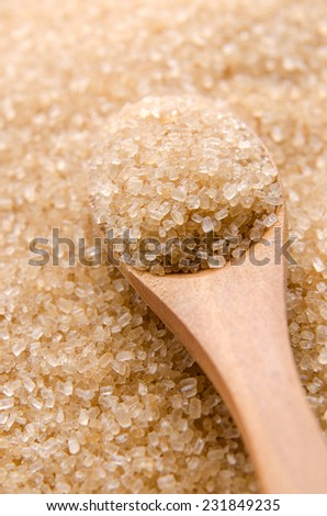 Healthier alternative brown sugar in a wood spoon. - stock photo