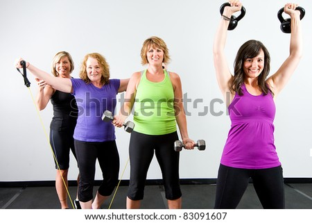 Healthy, active group of mature women working out with various equipment at a gym. - stock photo