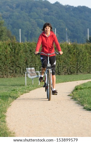 Healthy active Woman on a bike ride Outdoors