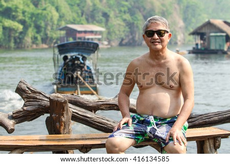 Healthy adults Holiday at Houseboat go to float raft downstream at the River Kwai Kanchanaburi of Thailand.
