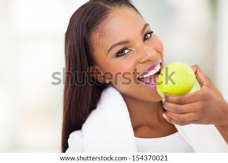 healthy african woman eating apple - stock photo
