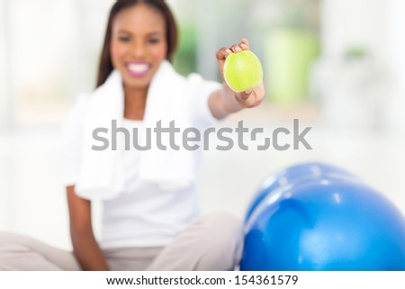healthy african woman holding a green apple