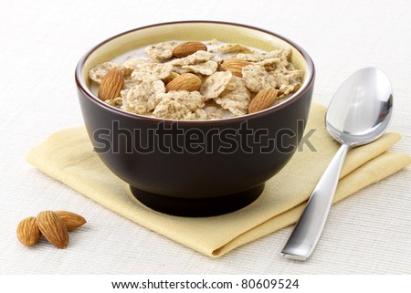 healthy almonds and riceflakes cereal with milk, part of a healthy nutrition program - stock photo