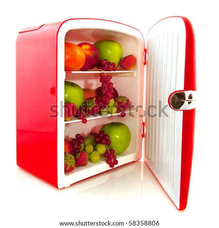 Healthy American red fridge filled with fruit for diet