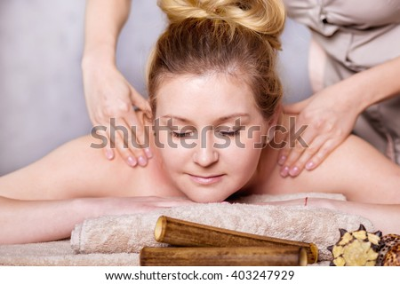 healthy  and beautiful blond woman in spa salon. Traditional oriental aroma therapy and beauty treatments. - stock photo