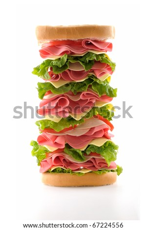 Healthy and big ham sandwich with lettuce, tomato and cheese isolated on white background. - stock photo