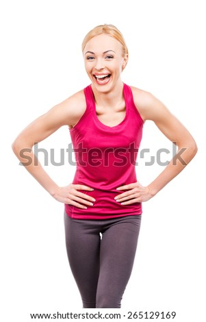 Healthy and cheerful. Cheerful mature women holding hands on her hips and laughing while standing against white background - stock photo