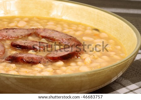 Healthy and delicious  white beans with aromatic sausage perfect mediterranean meal