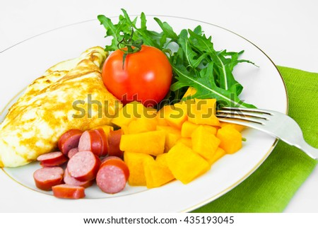 Healthy and Diet Food: Scrambled Eggs with Vegetables. Studio Photo