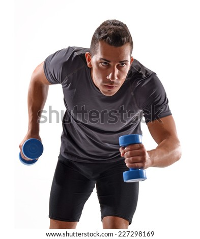 Healthy and fitness man running and holding gym weights on white background. - stock photo