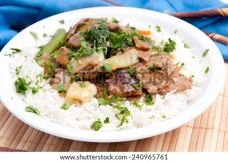 healthy and nutritious beef stir fry over white rice - stock photo