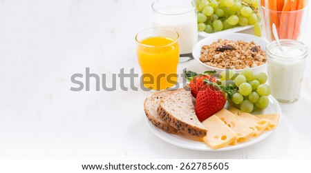 healthy and nutritious breakfast with fresh fruits and vegetables on white, close-up - stock photo