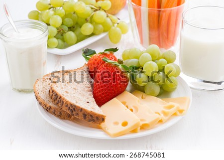 healthy and nutritious breakfast with fruits and vegetables, close-up, horizontal - stock photo