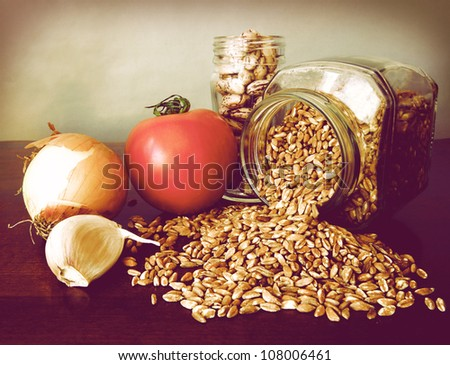 Healthy and tasteful soup ingredients : borlotti beans, emmer, onion, garlic and fresh tomatoes. Eat hot in winter, cold in summer. Emmer, farro in Italian, was the primary food of antique Romans. - stock photo