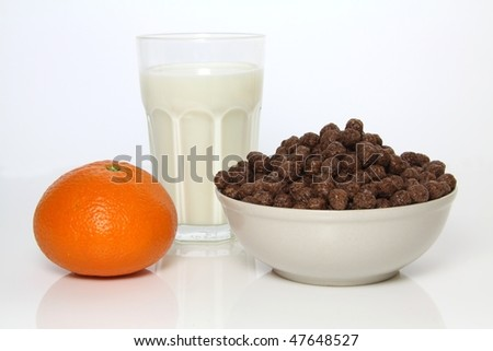 Healthy and tasty breakfast - milk, chocolate cereals and orange