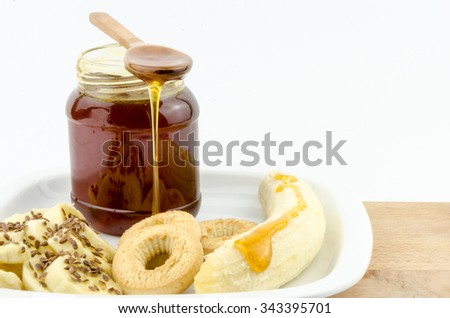 healthy and tasty dessert with banana, honey and flax