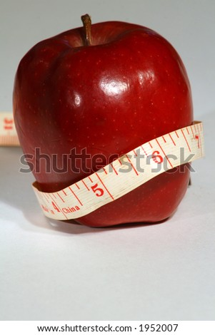 Healthy apple nutrition with tape measure - vertical