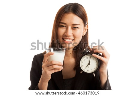 Healthy Asian woman drinking  glass of milk hold clock  isolated on white background. - stock photo