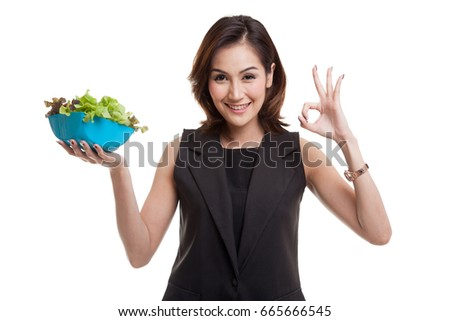 Healthy Asian woman show OK with salad isolated on white background