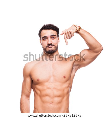 healthy athletic young man with muscle pointing down isolated on white
