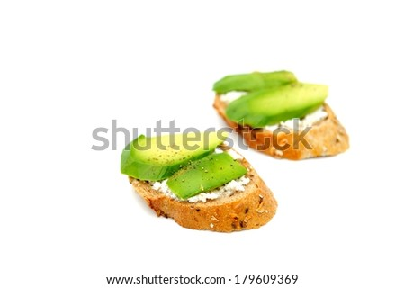Healthy avocado snacks on white background