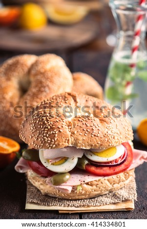 Healthy bagel sandwich with turkey breast and eggs,selective focus  - stock photo