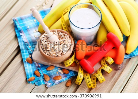 healthy banana cocktail with oats and almonds - diet and breakfast - stock photo