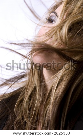 healthy beautiful long hair in motion created by wind, fashion look