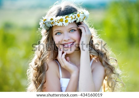 Healthy, beautiful smile, cute kid with dental braces smiling . Portrait of a little girl with orthodontic appliance.