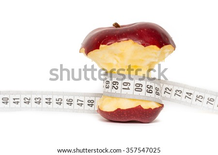 Healthy bitten red apple with measuring tape isolated on white background - stock photo