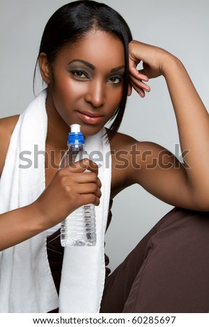 Healthy black woman drinking water - stock photo