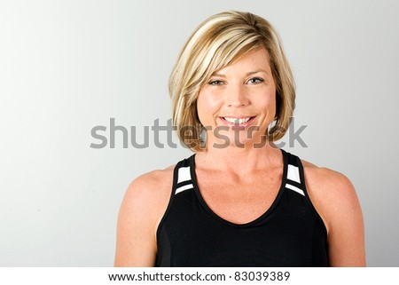 Healthy, blond, mature woman in workout clothes. - stock photo