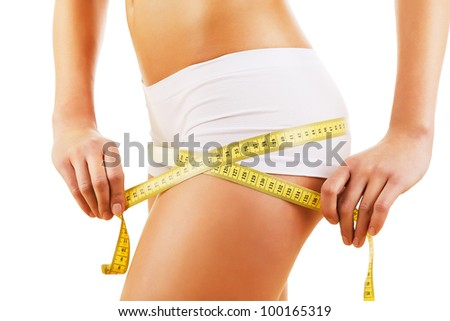 healthy body with tapemeasure on white background