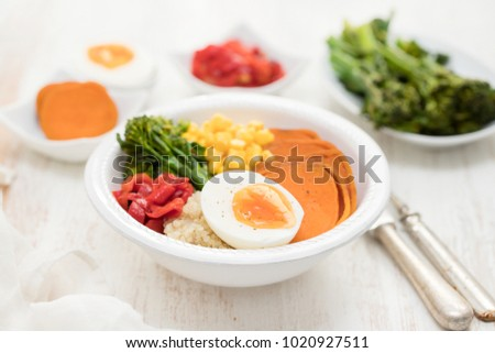 healthy bowl with vegetables and boiled egg