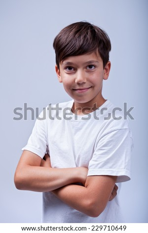 Healthy boy smiling with arms crossed -  portrait - stock photo