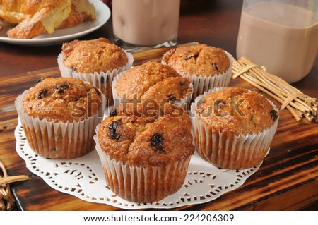 Healthy bran and raisin muffins with chocolate milk - stock photo