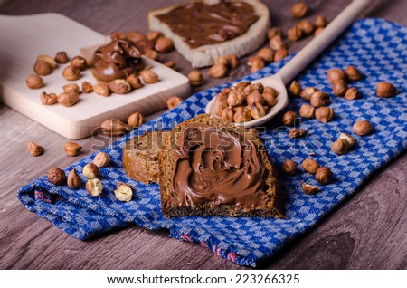 Healthy bread with Chocolate spread and nuts, all homemade - stock photo