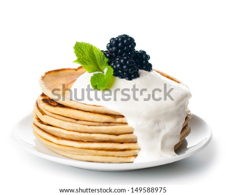 healthy breakfast: a stack of homemade pancakes with fresh blackberries and whipped cream, fruit, and coffee on a white background, isolated - stock photo