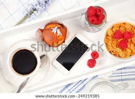 healthy breakfast and mobile phone - stock photo