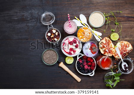 Healthy Breakfast cocnut milk and berries smoothie bowl with superfood ingredients, Clean eating breakfast concept, top view, white wooden table, rustic style - stock photo
