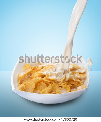 Healthy Breakfast-Cornflakes and Milk Splash - stock photo