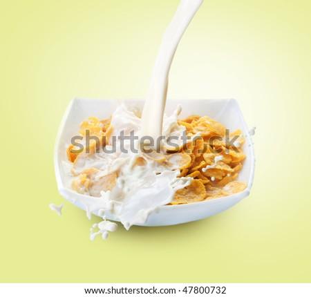 Healthy Breakfast-Cornflakes and Milk Splash - stock photo